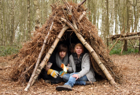 Couple in woodland shelter